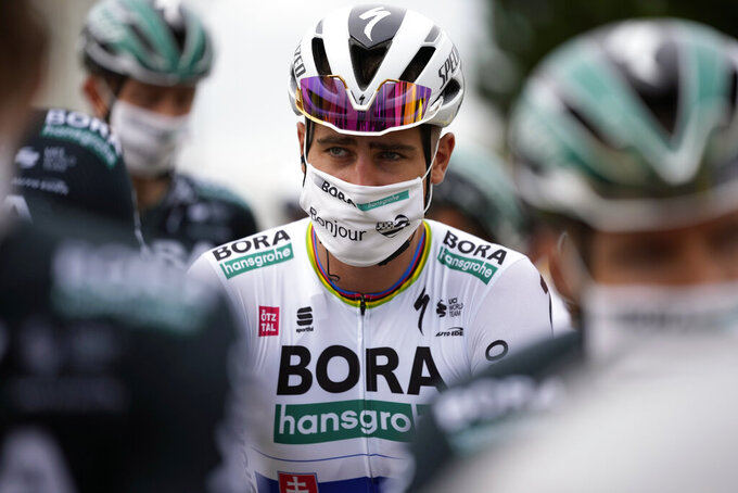 Solvakia's Peter Sagan attends the signing ceremony prior to the start of the first stage of the Tour de France cycling race over 197.8 kilometers (122.9 miles) with start in Brest and finish in Landerneau, France, Saturday, June 26, 2021. (AP Photo/Daniel Cole, Pool)