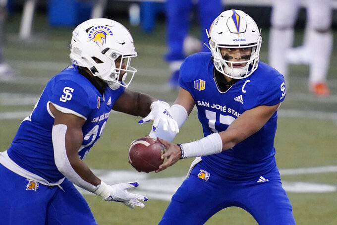 San Jose State quarterback Nick Starkel (17) hands off to running back Tyler Nevens (23) during the second half of an NCAA college football game against Boise State for the Mountain West championship, Saturday, Dec. 19, 2020, in Las Vegas. (AP Photo/John Locher)