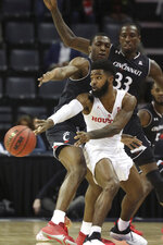 Cincinnati's Keith Williams and Nysier Brooks (33) defend against Houston's Corey Davis Jr. during the first half of the NCAA college basketball game for the American Athletic Conference men's tournament championship Sunday, March 17, 2019, in Memphis, Tenn. (AP Photo/Troy Glasgow)