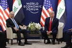 US President Donald Trump, right, attends a meeting with his Iraqi counterpart Barham Salih at the World Economic Forum in Davos, Switzerland, Wednesday, Jan. 22, 2020. Trump's two-day stay in Davos is a test of his ability to balance anger over being impeached with a desire to project leadership on the world stage. (AP Photo/Evan Vucci)