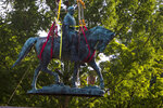 Workers remove the monument of Confederate General Robert E. Lee on Saturday, July 10, 2021 in Charlottesville, Va.   The removal of the Lee statue follows years of contention, community anguish and legal fights. (AP Photo/John C. Clark)