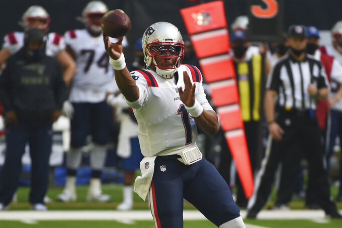 New England Patriots quarterback Cam Newton (1) throws against the Houston Texans during the first half of an NFL football game, Sunday, Nov. 22, 2020, in Houston. (AP Photo/Eric Christian Smith)