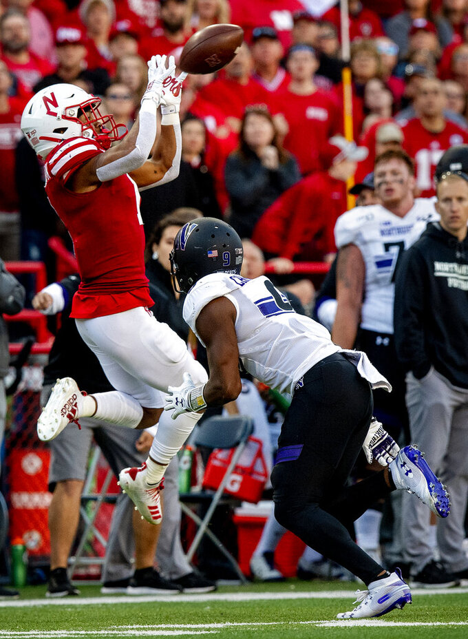 Nebraska wide receiver Wan'Dale Robinson (1) pulls in a pass from Nebraska quarterback Noah Vedral in front of Northwestern Roderick Campbell (9) during the second half of an NCAA college football game, Saturday, Oct. 5, 2019 in Lincoln, Neb. (Francis Gardler/Lincoln Journal Star via AP)
