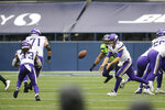 Minnesota Vikings quarterback Kirk Cousins (8) flips the ball to running back Dalvin Cook on a touchdown play against the Seattle Seahawks during the first half of an NFL football game, Sunday, Oct. 11, 2020, in Seattle. (AP Photo/John Froschauer)
