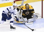 Boston Bruins goaltender Tuukka Rask (40) makes a save against Tampa Bay Lightning center Anthony Cirelli (71) during the second period of an NHL hockey playoff game  Wednesday, Aug. 5, 2020 in Toronto. (Nathan Denette/The Canadian Press via AP)