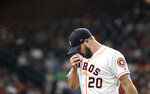 Houston Astros starting pitcher Wade Miley wipes his face as he walks toward the dugout after being pulled during the first inning of a baseball game against the Oakland Athletics Tuesday, Sept. 10, 2019, in Houston. (AP Photo/David J. Phillip)