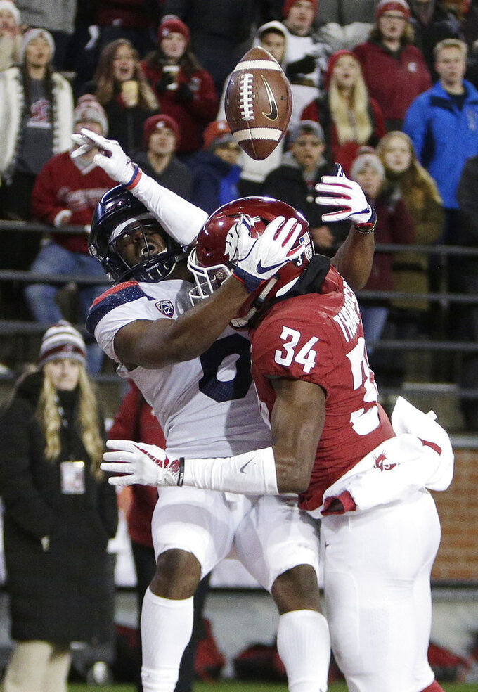 Washington State safety Jalen Thompson (34) disrupts a pass intended for Arizona wide receiver Shun Brown during the first half of an NCAA college football game in Pullman, Wash., Saturday, Nov. 17, 2018. (AP Photo/Young Kwak)