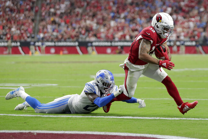 Arizona Cardinals wide receiver Christian Kirk (13) scores a two point conversion to tie the game as Detroit Lions defensive back Tracy Walker (21) defends during the second half of an NFL football game, Sunday, Sept. 8, 2019, in Glendale, Ariz. (AP Photo/Darryl Webb)