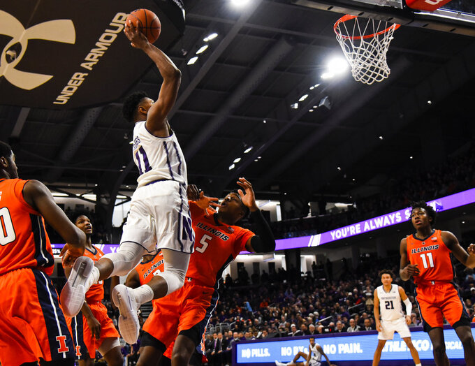 Northwestern guard Anthony Gaines (11) shoots over Illinois guard Tevian Jones (5) during the first half of an NCAA college basketball game on Sunday, Jan. 6, 2019, in Evanston, Ill. (AP Photo/Matt Marton)