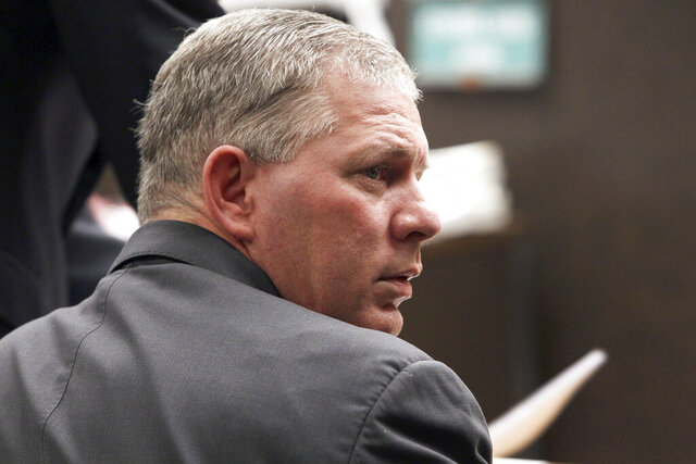 FILE - In this March 5, 2012, file photo, former All-Star outfielder Lenny Dykstra is seen during his sentencing for grand theft auto in the San Fernando Valley section of Los Angeles. A judge has dismissed Lenny Dykstra's defamation lawsuit against former New York Mets teammate Ron Darling, Friday, May 29, 2020, ruling the outfielder's reputation already was so tarnished it could not be damaged more.  (AP Photo/Nick Ut, File)