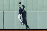 Tampa Bay Rays' Manuel Margot cannot get a triple off the wall by Boston Red Sox's Taylor Motter during the sixth inning of a baseball game Monday, Sept. 6, 2021, at Fenway Park in Boston. (AP Photo/Winslow Townson)