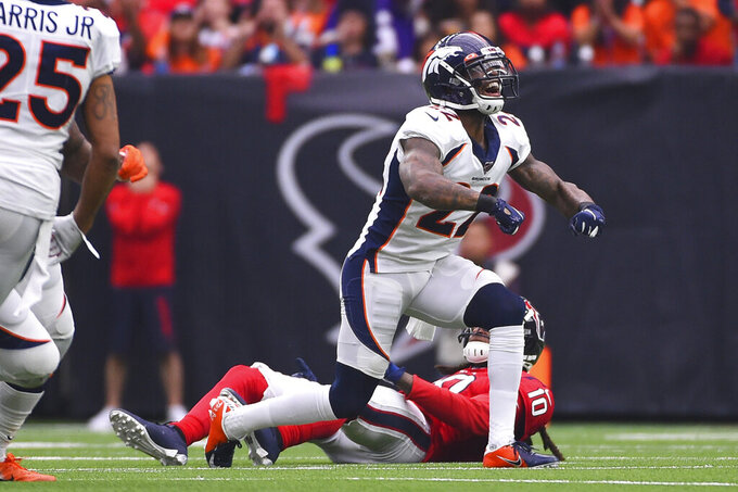 Denver Broncos strong safety Kareem Jackson (22) celebrates after breaking up a pass intended for Houston Texans wide receiver DeAndre Hopkins (10) during the first half of an NFL football game Sunday, Dec. 8, 2019, in Houston. (AP Photo/Eric Christian Smith)