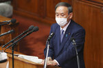 Japanese Prime Minister Yoshihide Suga delivers a policy speech during an extraordinary Diet session at the upper house of parliament in Tokyo, Monday, Oct. 26, 2020. Suga has declared Japan will achieve zero carbon emissions by 2050 in his first policy speech after taking over from Shinzo Abe. The policy speech Monday at the outset of the parliamentary session set an ambitious agenda reflecting Suga's pragmatic approach to getting things done. (AP Photo/Koji Sasahara)