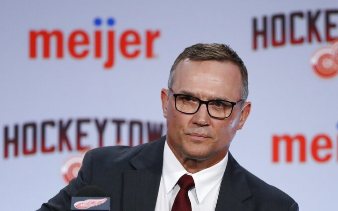 File- This April 19, 2019, file photo shows Steve Yzerman being introduced as the new executive vice president and general manager of the Detroit Red Wings during a news conference,  in Detroit.  The Red Wings are sticking with coach Jeff Blashill for their rebuild. Yzerman made the announcement Tuesday,  May 18, 2021, giving Blashill a contract extension despite a five-year postseason drought and a career record of 172-221-62.  (AP Photo/Carlos Osorio, File)