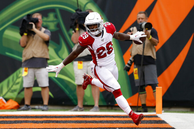 Arizona Cardinals running back Chase Edmonds scores a touchdown in the second half of an NFL football game against the Cincinnati Bengals, Sunday, Oct. 6, 2019, in Cincinnati. (AP Photo/Gary Landers)