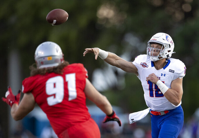 Houston Baptist quarterback Blaise Bentsen (18) throws a pass against New Mexico during the first half of an NCAA college football game Thursday, Sept. 2, 2021, in Albuquerque, N.M. (AP Photo/Andres Leighton)