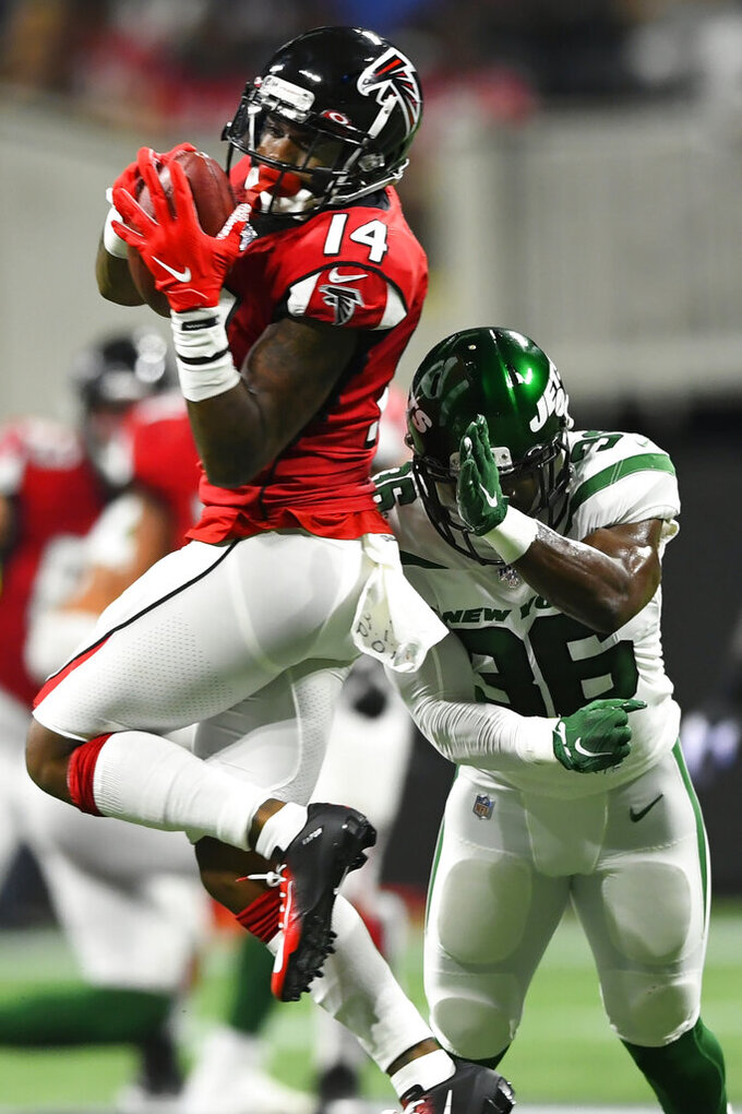 Atlanta Falcons wide receiver Justin Hardy (14) makes the catch against New York Jets defensive end Henry Anderson (96) during the first half an NFL preseason football game, Thursday, Aug. 15, 2019, in Atlanta. (AP Photo/John Amis)