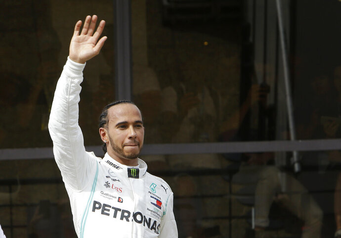 Mercedes driver Lewis Hamilton of Britain, waves his fans after winning the French Formula One Grand Prix at the Paul Ricard racetrack in Le Castellet, southern France, Sunday, June 23, 2019. (AP Photo/Claude Paris)