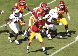 Quarterback Kedon Slovis #9 of the USC Trojans passes against the Arizona State Sun Devils in the second half of a NCAA football game at the Los Angeles Memorial Coliseum in Los Angeles on Saturday, November 7, 2020. USC Trojans won 28-27. (Keith Birmingham/The Orange County Register via AP)