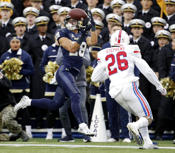Navy wide receiver Keoni-Kordell Makekau (28) tries to make a catch before SMU defensive back Brandon Stephens (26) knocks the ball on a hit during the first half of an NCAA college football game, Saturday, Nov. 23, 2019, in Annapolis, Md. (AP Photo/Julio Cortez)