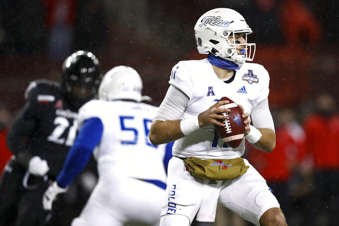 Tulsa quarterback Zach Smith looks to pass during the first half of the American Athletic Conference championship NCAA college football game against Cincinnati, Saturday, Dec. 19, 2020, in Cincinnati. (AP Photo/Aaron Doster)