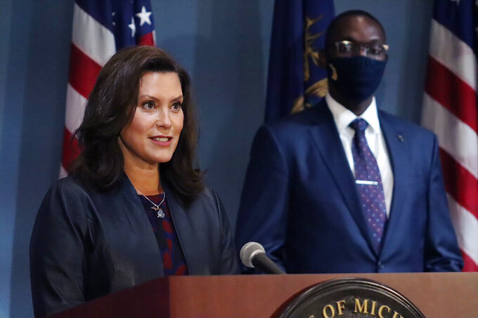 """In a photo provided by the Michigan Office of the Governor, Gov. Gretchen Whitmer addresses the state during a speech in Lansing, Mich., Wednesday, Sept. 2, 2020. The governor said she will make an announcement on reopening gyms and clarifying the standing of high school and other youth sports """"very soon,"""" saying she knows many are anxious about their status amid the coronavirus pandemic. (Michigan Office of the Governor via AP)"""