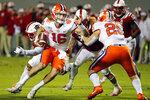 Clemson's Trevor Lawrence (16) runs the ball around the block of teammate J.C. Chalk (25) during the first half of an NCAA college football game against North Carolina State, in Raleigh, N.C., Saturday, Nov. 9, 2019. (AP Photo/Karl B DeBlaker)