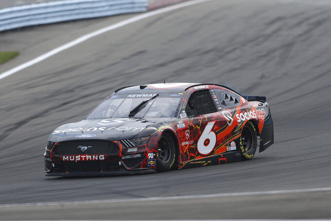 Ryan Newman drives through Turn 1 during a NASCAR Cup Series auto race in Watkins Glen, N.Y., on Sunday, Aug. 8, 2021. (AP Photo/Joshua Bessex)