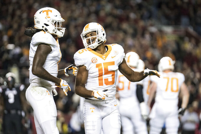 Tennessee wide receivers Jauan Jennings (15) and Marquez Callaway (1) celebrate a touchdown during the first half of an NCAA college football game against South Carolina Saturday, Oct. 27, 2018, in Columbia, S.C. (AP Photo/Sean Rayford)