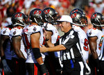 FILE - In this Sept. 30, 2012, file photo, NFL official Al Riveron speaks with Tampa Bay Buccaneers defensive tackle Daniel Te'o-Nesheim (50) during an NFL football game in Tampa, Fla. Riveron, a Cuban who became the league's first Hispanic referee, is retiring Friday, Aug. 6, 2021. Riveron worked as an on-field official for nine years and became a member of the NFL's officiating staff in 2013. (AP Photo/Brian Blanco, File)