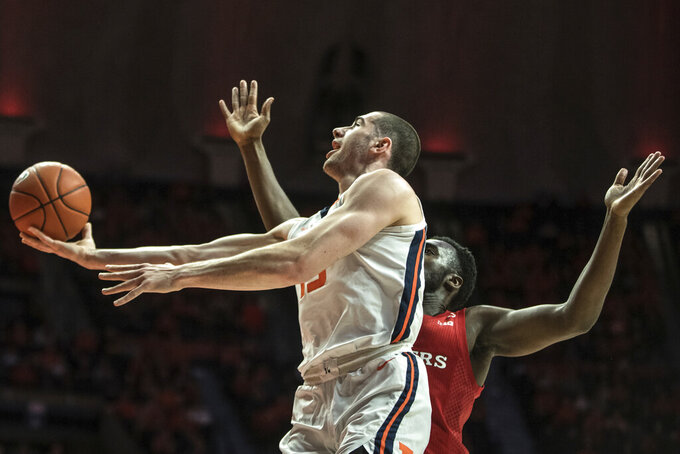 Illinois' Giorgi Bezhanishvili (15) goes to the basket as Rutgers' Shaq carter defends in the first half of an NCAA college basketball game, Sunday, Jan. 11, 2020, in Champaign, Ill. (AP Photo/Holly Hart)