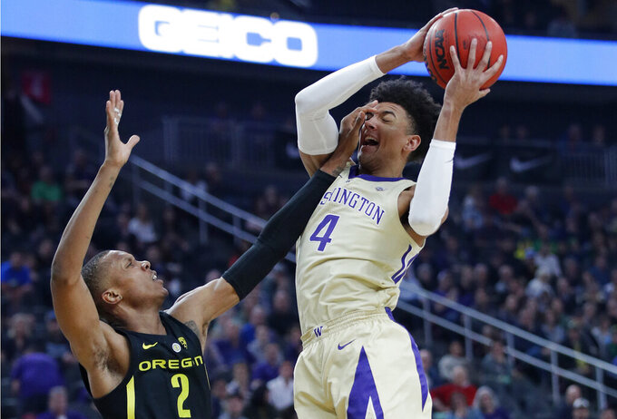 Washington's Matisse Thybulle attempts a shot over Oregon's Louis King during the first half of an NCAA college basketball game in the final of the Pac-12 men's tournament Saturday, March 16, 2019, in Las Vegas. (AP Photo/John Locher)