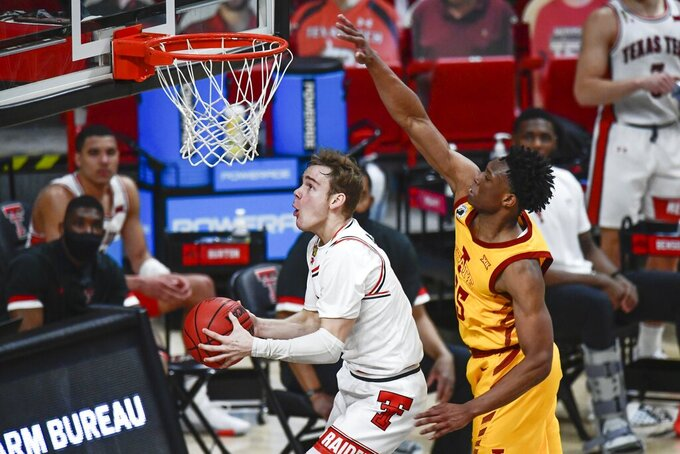 Texas Tech's Mac McClung, left, shoots next to Iowa State's Darlinstone Dubar (55) during the second half of an NCAA college basketball game in Lubbock, Texas, Thursday, March 4, 2021. (AP Photo/Justin Rex)
