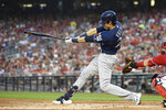 Milwaukee Brewers' Christian Yelich follows through on a two-run single during the third inning of a baseball game against the Washington Nationals, Saturday, Aug. 17, 2019, in Washington. (AP Photo/Nick Wass)