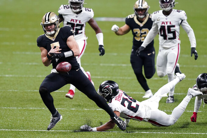 New Orleans Saints quarterback Taysom Hill (7) fumbles on a carry as he is tripped up by Atlanta Falcons cornerback A.J. Terrell in the second half of an NFL football game in New Orleans, Sunday, Nov. 22, 2020. (AP Photo/Butch Dill)