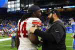 New York Giants linebacker Markus Golden (44) is greeted by Detroit Lions head coach Matt Patricia after an NFL football game, Sunday, Oct. 27, 2019, in Detroit. (AP Photo/Rick Osentoski)