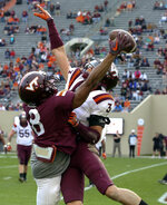 Virginia wide receiver Phil Patterson (8) makes a one-handed catch for a touchdown on a pass from quarterback Ryan Willis past defensive back Caleb Farley (3) during the NCAA college football team's Maroon-White spring game in Blacksburg, Va., Saturday, April 13, 2019. (Matt Gentry/The Roanoke Times via AP)