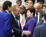 IOC member John Coates, center left, talks with Tokyo Governor Yuriko Koike as they leave the Four-Party Representative Meeting in Tokyo Friday, Nov. 1, 2019. Next year's Olympic marathons and race walks will be run in the northern city of Sapporo as the IOC has followed through with a controversial plan to move from Tokyo to the cooler northern city. (Kimimasa Mayama /Pool Photo via AP)