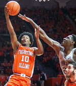 Illinois guard Andres Feliz (10) shoots as Penn State' forward Mike Watkins (24) defends during the first half of an NCAA college basketball game in Champaign, Ill., Saturday, Feb. 23, 2019.(AP Photo/Robin Scholz)
