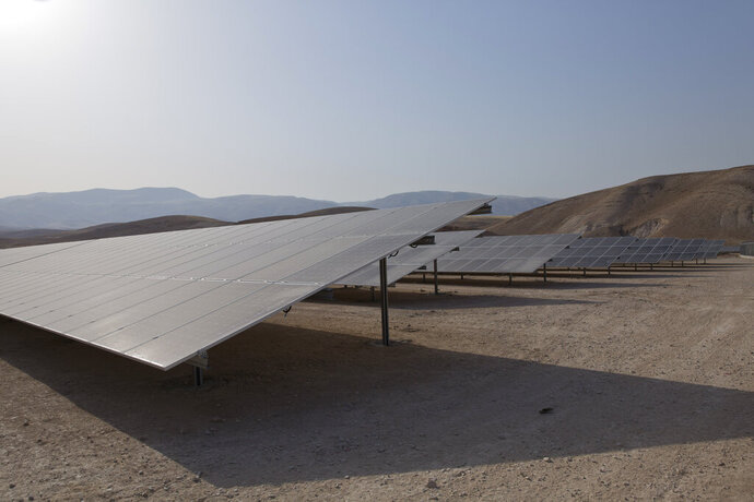 This Tuesday, May 21, 2019 photo, shows solar panels at the newly inaugurated Nour Jericho solar plant, in the ancient West Bank city of Jericho. Mohammed Mustafa, head of the government's investment fund, said Wednesday that the plant is one of four planned plants. He said the Palestinians rely almost entirely on power imported from Israel and the new plants are part of a long-term project to reduce that by 50% over the next decade. (AP Photo/Nasser Nasser)