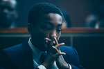 This image released by Netflix shows Asante Blackk as young Kevin Richardson in a scene from