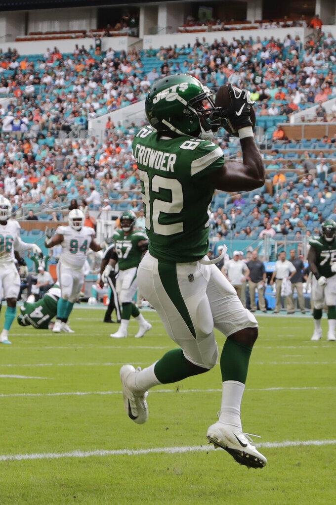 New York Jets wide receiver Jamison Crowder (82) catches the ball and runs in for a touchdown against the Miami Dolphins during the first half of an NFL football game, Sunday, Nov. 3, 2019, in Miami Gardens, Fla. (AP Photo/Lynne Sladky)
