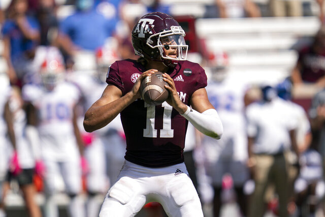 Texas A&M quarterback Kellen Mond (11) looks downfield to pass against Florida during the second half of an NCAA college football game, Saturday, Oct. 10, 2020. in College Station, Texas. (AP Photo/Sam Craft)