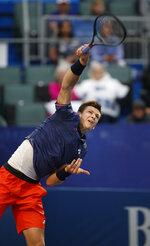 Hubert Hurkacz, of Poland, serves to Benoit Paire, of France, in the championship match of the Winston-Salem Open tennis tournament in Winston-Salem, N.C., Saturday, Aug. 24, 2019. Hurkacz won 6-3, 3-6, 6-3. (AP Photo/Nell Redmond)