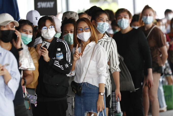Workers in a local entertainment venue area line up for the coronavirus test in Bangkok, Thailand, Thursday, April 8, 2021. Thailand has confirmed its first local cases of the coronavirus variant first detected in the U.K., raising the likelihood that it is facing a new wave of the pandemic, a senior doctor said Wednesday. (AP Photo/Sakchai Lalit)