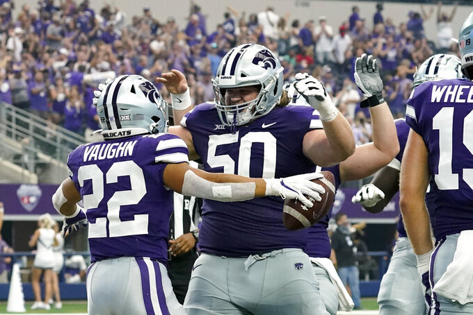 Kansas State running back Deuce Vaughn (22) celebrates his touchdown run with offensive lineman Cooper Beebe (50) in the first half of an NCAA college football game against Stanford in Arlington, Texas, Saturday, Sept. 4, 2021. (AP Photo/Tony Gutierrez)