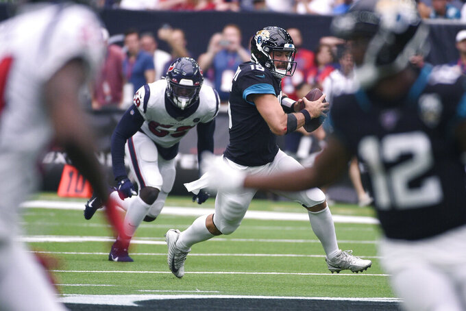 Jacksonville Jaguars quarterback Gardner Minshew (15) scramble for yards against the Houston Texans during the second half of an NFL football game Sunday, Sept. 15, 2019, in Houston. (AP Photo/Eric Christian Smith)