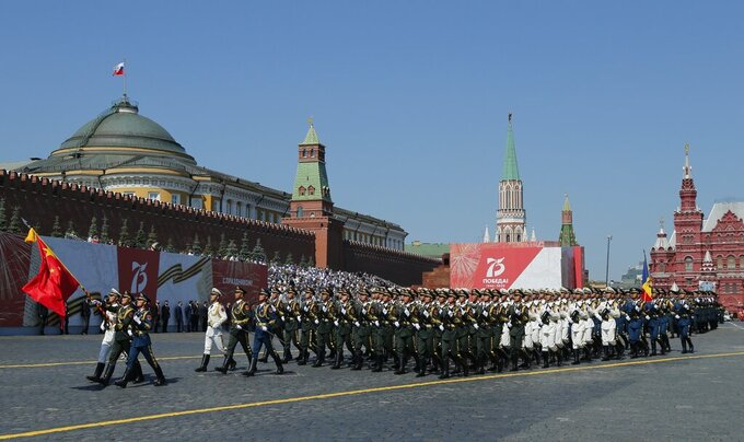 FILE - In this June 24, 2020 file photo, soldiers from China's People's Liberation Army march toward Red Square during the Victory Day military parade marking the 75th anniversary of the Nazi defeat in Red Square in Moscow, Russia. Chinese and Russian forces will take part in joint military exercises in southern Russia later in September along with troops from Armenia, Belarus, Iran, Myanmar, Pakistan and others, China's defense ministry announced Thursday, Sept. 10, 2020. (AP Photo/Alexander Zemlianichenko, File)