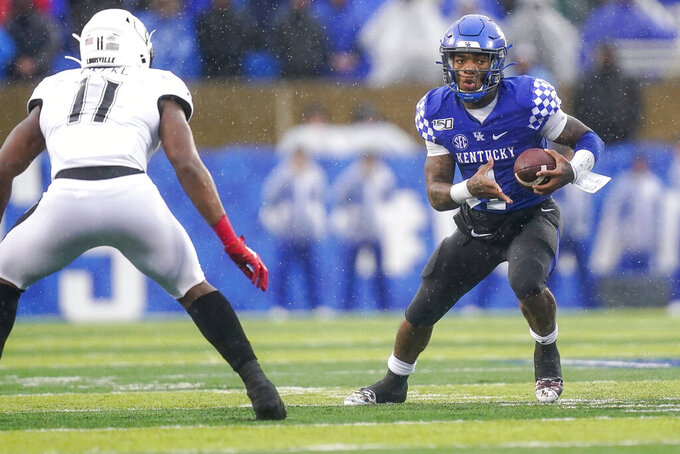 Kentucky quarterback Lynn Bowden Jr. (1) runs with the ball during the second half of the NCAA college football game against Louisville, Saturday, Nov. 30, 2019, in Lexington, Ky. (AP Photo/Bryan Woolston)