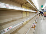 A man shops near empty shelves at a supermarket in Tateyama, Chiba prefecture, near Tokyo as Typhoon Hagibis approaches Friday, Oct. 11, 2019. A powerful typhoon is forecast to bring up to 80 centimeters (31 inches) of rain and damaging winds to the Tokyo area and Japan's Pacific coast this weekend, and the government is warning residents to stockpile necessities and leave high-risk places before it's too dangerous. (Naoya Osato/Kyodo News via AP)